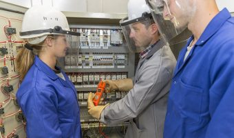 Female Metering Apprentice with Male Apprentice and Supervisor